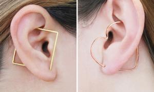 Otis Jaxon crée des boucles d'oreilles jouant avec de petites illusions d'optique